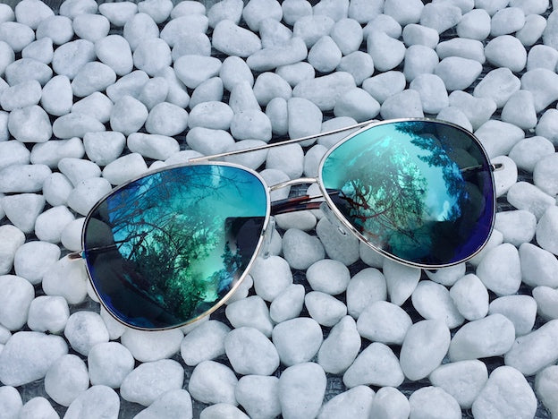 Awesome Aviators with UVA/UVB protection and marine blue polarizing lenses feel good, look good and rock the retro fashion vibe.