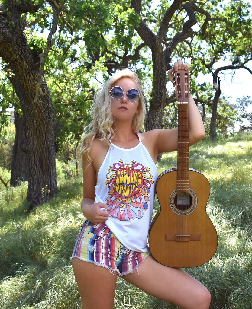 Shop women's retro & vintage inspired tops and accessories like this Feeling Groovy strappy tank and you be ready for a summer of love. Hand drawn designs and vibrant colors inspired by our favorite 60's & 70's artists. Made in LA with love.