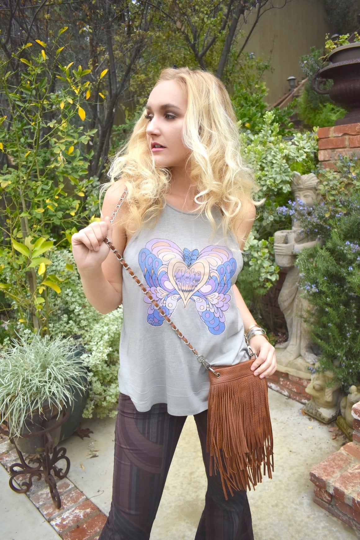 Fly. Be free.  Be Bold.  Spread your wings and take flight in our strappy gray swing tank.  Inspired by the great 60s/70s artist, Peter Max, our original artwork butterfly jersey tank lets you fly high in retro style!