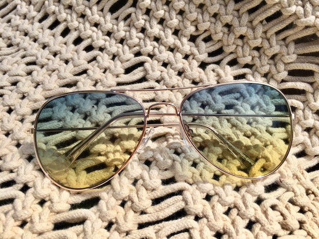 Shop women's sunglasses and let your imagination run away with you in Daydreamer Aviator shades with blue yellow tint. Discount prices and retro styles that rock your world.