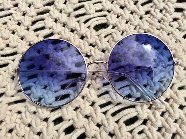 You'll feel like a real 60's rock star when you wear our Groovy Blues women's sunglasses. Their round frames with blue tinted lense and UVA/UVB protection won't disappoint you.