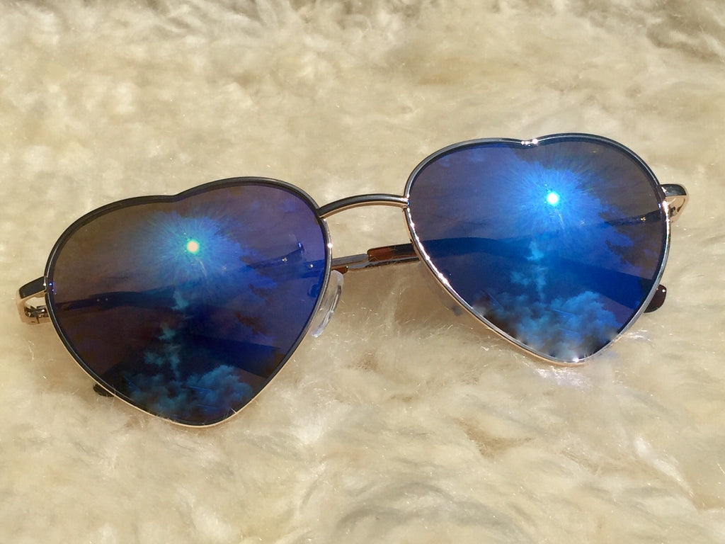Our heart shaped Hippie Love  sunglasses with Royal Blue lense & UVA/UVB protection are reminders to  love yourself, love others and love the world around you.