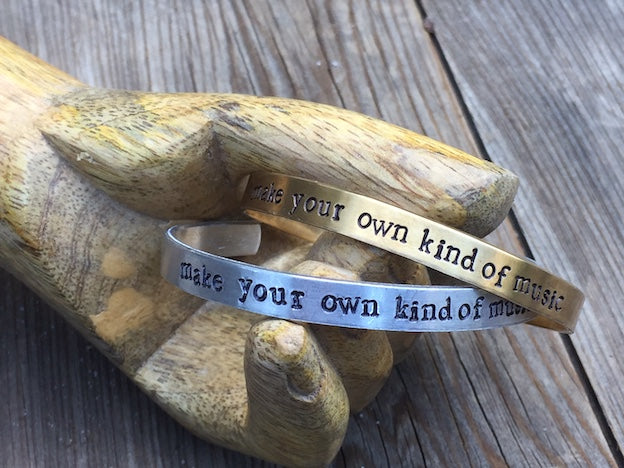 Here's a bracelet that celebrates your uniqueness.  Make Your Own Kind Of Music in Brass or Aluminum, is hand stamped, adjustable and made in Los Angeles by local artists.
