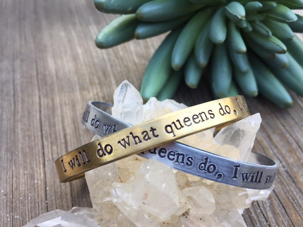 "This hand-stamped,  adjustable fit  I Will Do What Queens Do bracelet in aluminum or brass measures 1/4″ by 6"". This bracelet is made to order in Los Angeles by local artists."