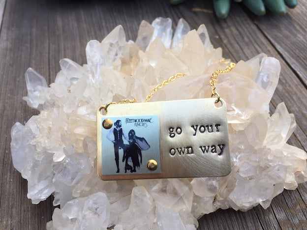 If you love Stevie Nicks you'll looove this Go Your Own Way necklace. Hand Stamped in Brass and Aluminum with iconic Fleetwood Mac image, this item is made in Los Angeles by local artists.