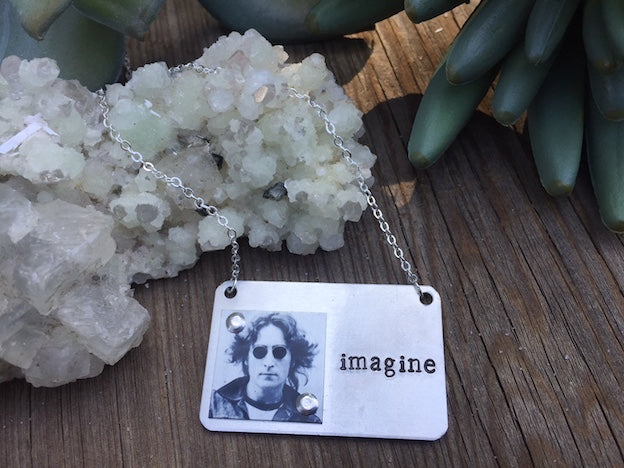 Women's necklaces rule! Celebrate the life, music and creativity of John Lennon with this Imagine necklace. Made from Durable Steel with Copper Plaque and iconic Lennon image, this is a rare find made in Los Angeles by local artists.
