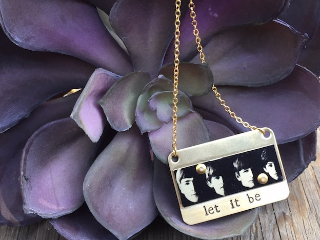 Women's jewelry like this amazing necklace will make you feel like a rock goddess! Made from Aluminum and Brass with iconic Fab 4 image, this Let It Be necklace is hand stamped and made in Los Angeles by local Artists.