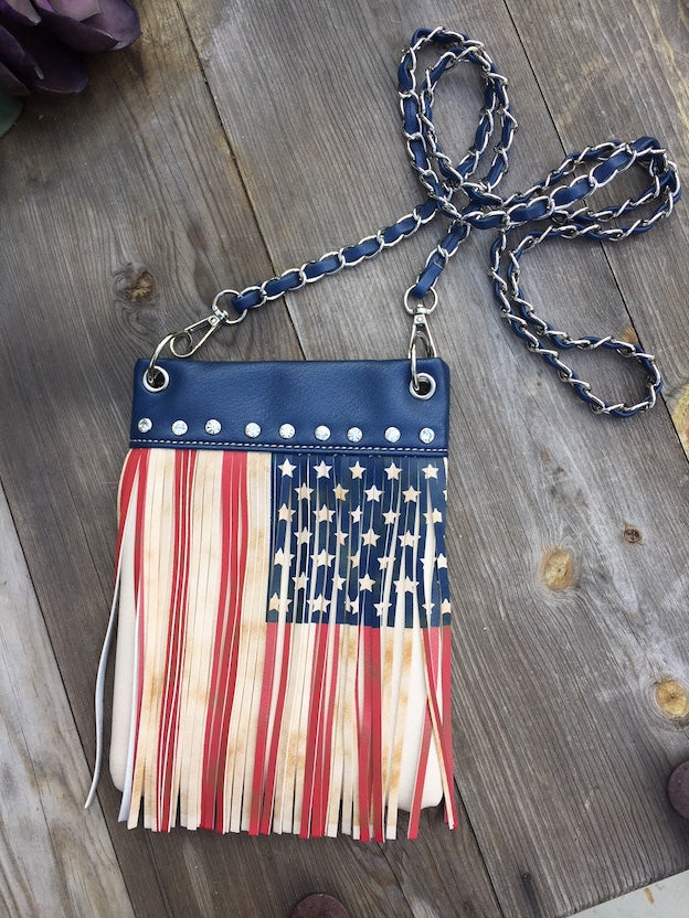 Celebrate our diverse America with this American FLAG number with fringe, studs and Outside Pocket - Open Sleeve, 2 Pockets on the inside - one main and one small and measures 6x8x1 for all your Groupie goodies.