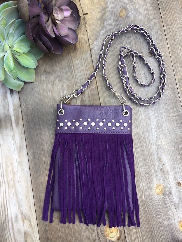 Women's bags, like our Purple Rain handbag are fun every time your wear them to a concert or just hanging out with your friends. This studded, frilled number measures 6x8x1 and has a long cross body strap with pockets for your keys, lip gloss and munchies.