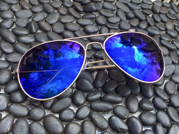 Midnight Blue lenses with UVA/UVB protection set off these Mirrored Aviators and put you at the head of the line.