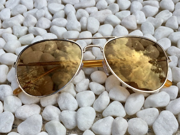 Mellow Smoke colored lenses with UVA/UVB protection have a mellow vibe and groovy look on these Aviators.