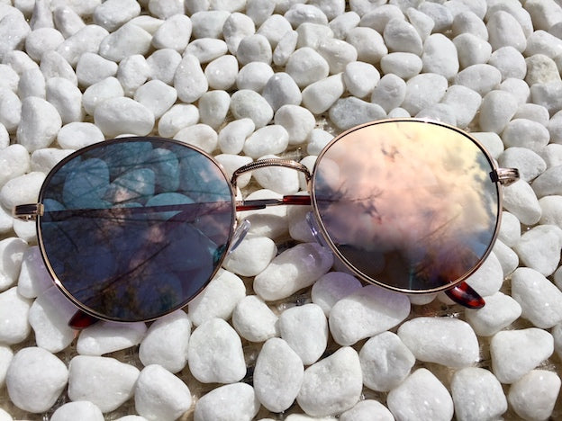Gold Dust Woman mirrored sunglasses with Rose Gold metal frames on these mirrored sunglasses look good in the desert or at the beach. Keep your dreams alive wherever you go.