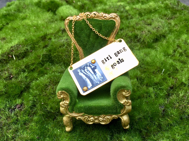 This Girl Gang Goals necklace feels like success around your neck. Hand-stamped by local LA artists, brass and copper... this original design features a vintage photo of the GTO's, the wildest Girl Gang of all.