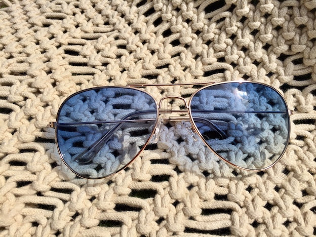In The Clouds Aviator sunglasses are for the high fliers and brave hearts how aren't afraid to soar. Blue tint and UVA/UVB protection look fab and protect your eyes.