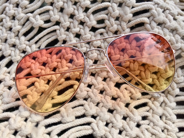 SHOP SUNGLASSES... Bring the sunshine into your life with Aviators with pink yellow ombre tint,  UVA/UVB protection and uber comfortable fit. Good for your eyes and great for your vibes.