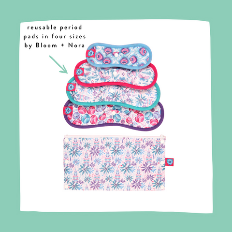 set of reusable period pads by bloom and nora with a floral storage bag