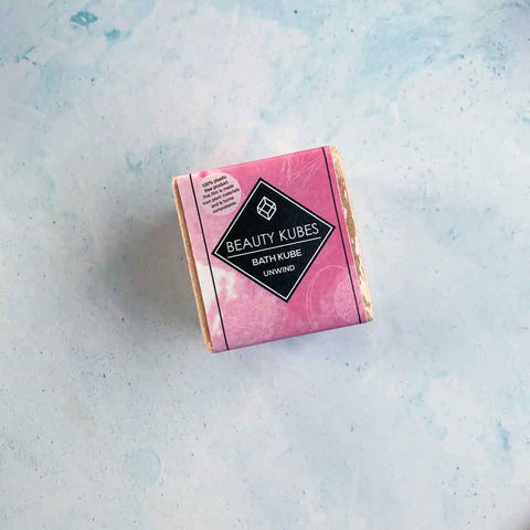 beauty kubes unwind bath cube in pink paper packaging