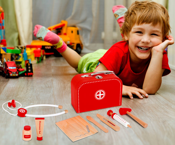 boy playing with Small Foot Doctors Case