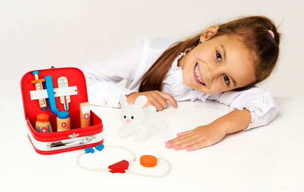 girl playing with Small Foot Vets Case Play Set
