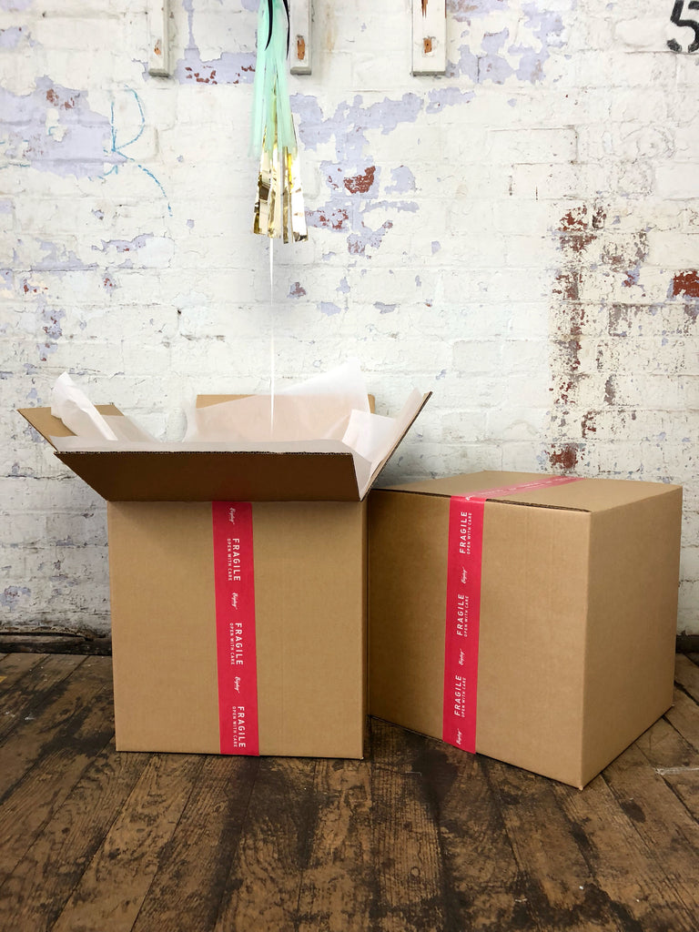 Balloon in a box delivery Melbourne | The Heyday Club