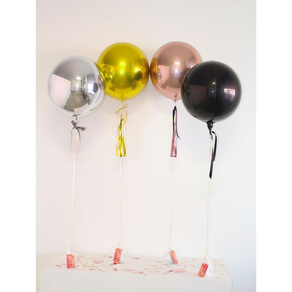 Metallic orb balloons from The Heyday Club | Rose gold, black, silver