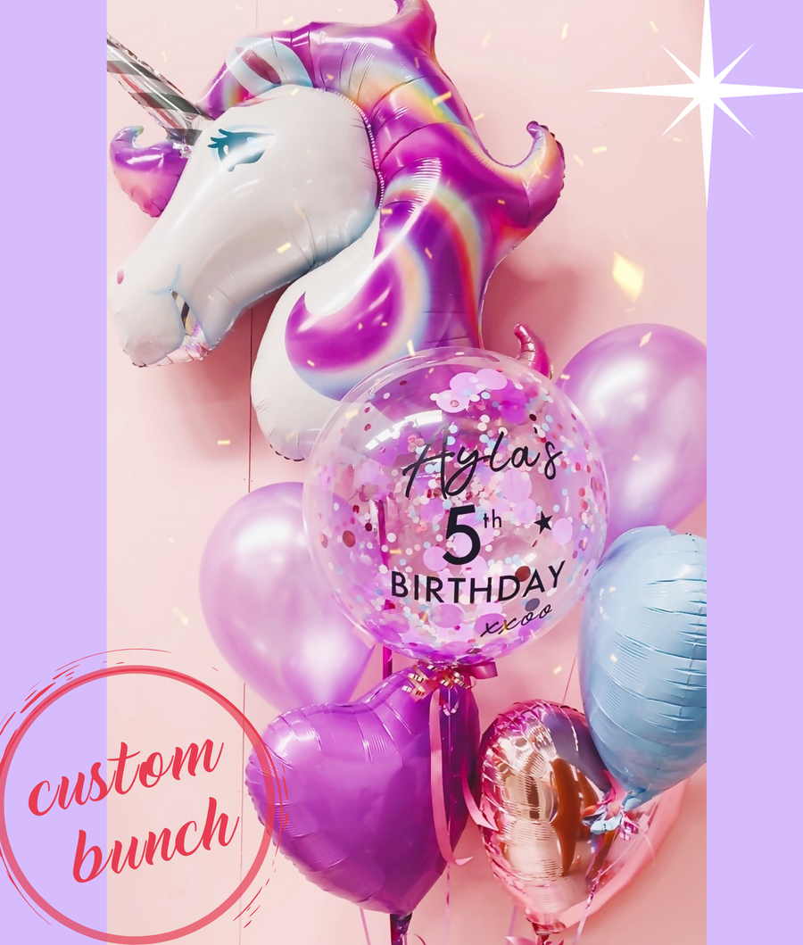 Custom balloon bouquet. This includes helium filled unicorn, love heart balloons and a personalised bubble balloon.