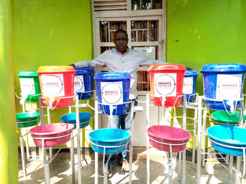 Herman with handwashing stations in Minova, DRC 2020