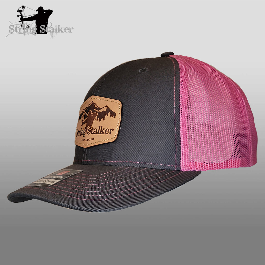 New Mountain String Stalker Leather Patch Charcoal/Neon Pink trucker hat.