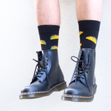 man wearing dr martens 1460 smooth black boots and lafitte taco print socks