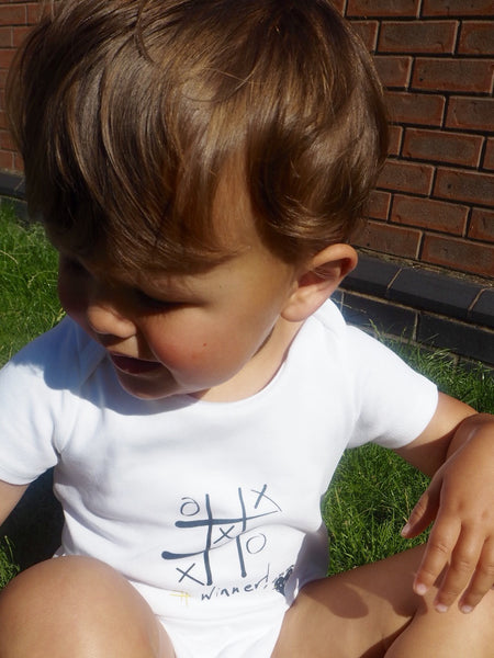 'Winner' organic cotton babygrow