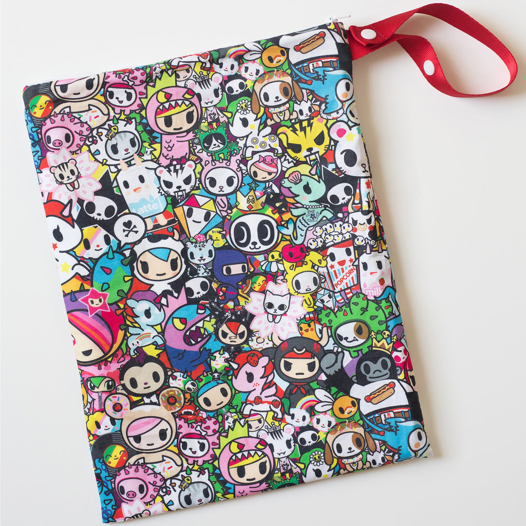Itzy Ritzy x Tokidoki  Travel Happens Tokidoki Allstars Sealed Wet Bag with Adjustable Handle