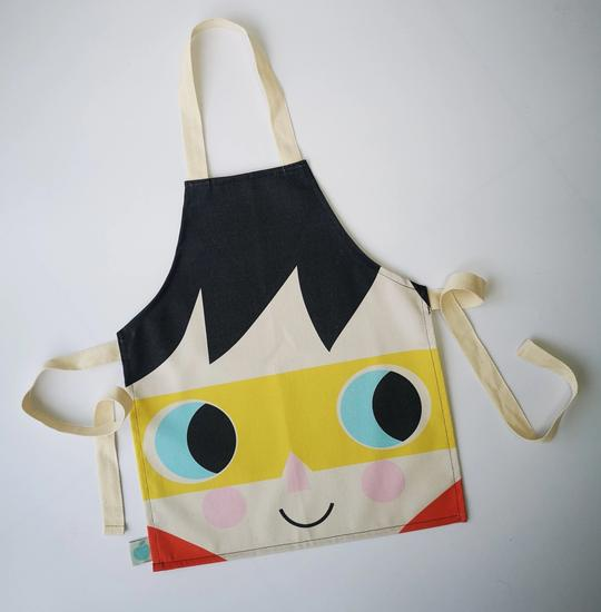 Children's cotton apron featuring a masked super boy with black hair.