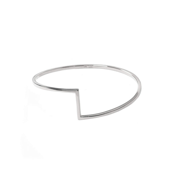 Flat backed bangle with curved rounded edges with a geometric design to the centre of the bangle.