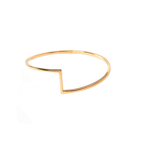 Flat backed bangle with rounded curved edges and a geometric design to the front of the bangle.