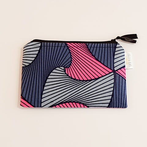 This versatile small fabric bag is pink with two shades of grey and the bold outline pattern is black and the wipe clean inner fabric is black.