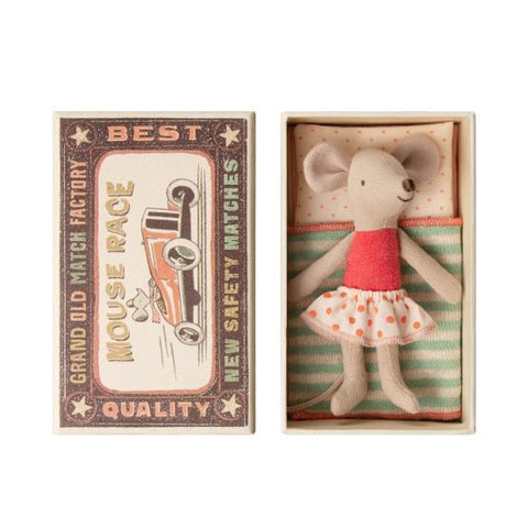 Mouse with polka dot skirt in matchbox with bedding.
