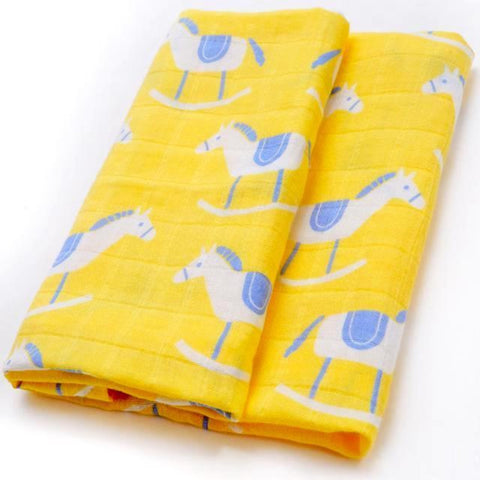 Soft organic cotton muslin cloth with a blue and white rocking horse repeat pattern on a sunny yellow background.