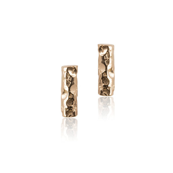 Small bar stud earring with hammered surface texture.