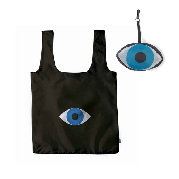Fold up reusable bag black with blue eye shape on the center.