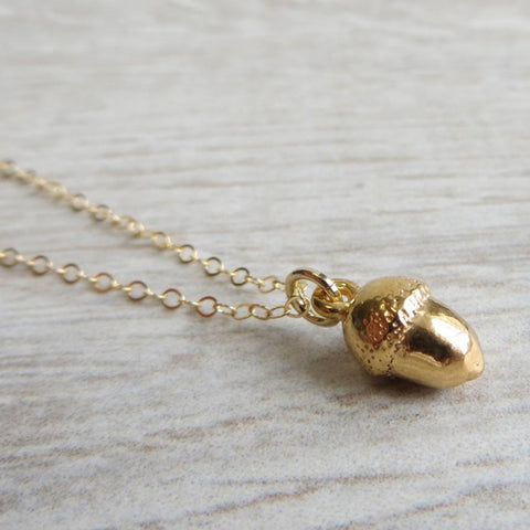 Baby gold plated acorn charm necklace