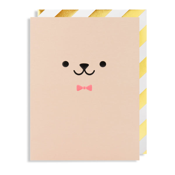 Dusky pink coloured card has a embossed cute creature face on the front with a neon pink bow tie.