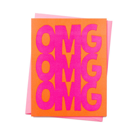 OMG text in neon pink with bright orange background blank greetings card with pink envelope.