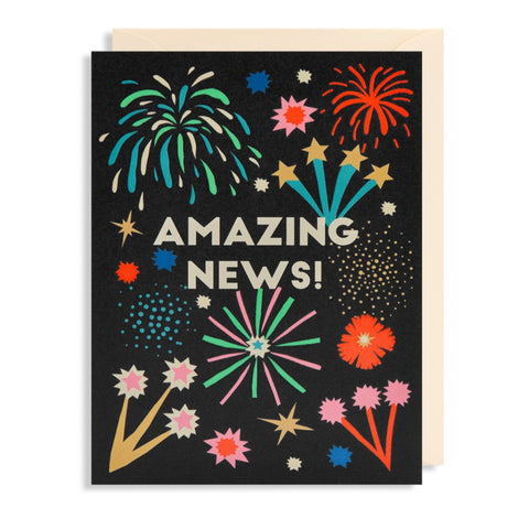 Amazing News card with embossed fire work explosion design on a black background.