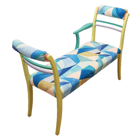 The upholstery and wooden structure is decorated with playful bright but subtle pastel colours. The seating area and tops of the chaise at the ends, have been covered in a beautiful velvet fabric with a colourful geometric pattern. Blues, mint green, yellow, lilac and coral. The main part of the wooden area has been mainly painted in yellow, and the struts are lilac and jade.