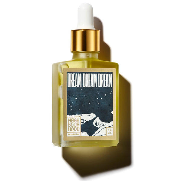 Facial oil in a bottle with the text 'Dream Dream Dream'