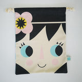 Cotton drwastring bag with little girls face on the front and a harlequin pattern in blue and white on the reverse.