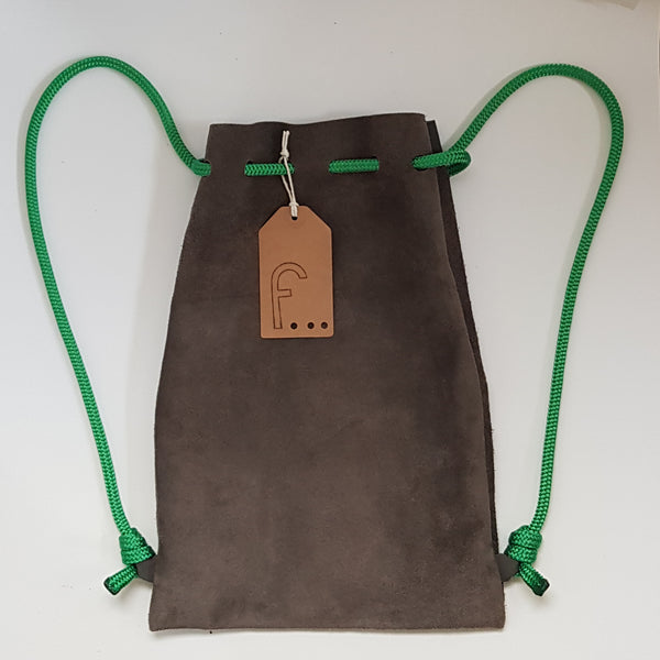 The backpack is made from dark green suede and the corresponding cord is a super soft apple green. This backpack is not lined.