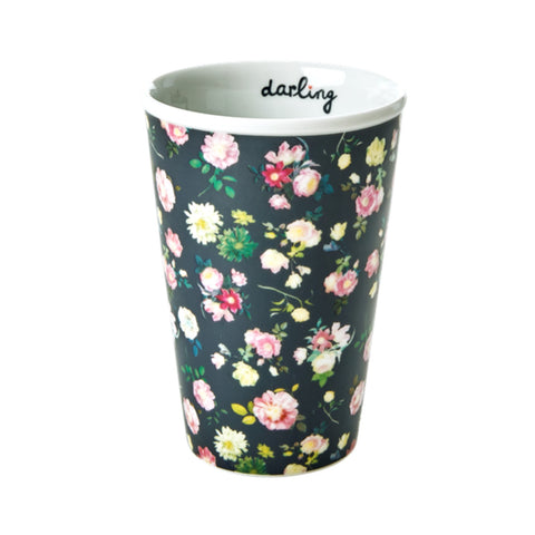 Porcelain cup with floral pattern and the word Darling printed inside the cup.