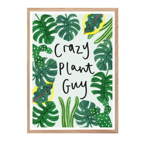Print with the text 'crazy plant guy' surrounded by tropical leaves on a pale blue background.