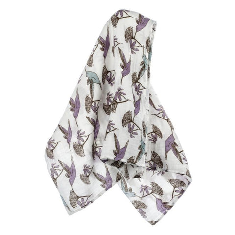 Soft organic cotton muslin cloth with humming birds and flowers epeat pattern on a white background.